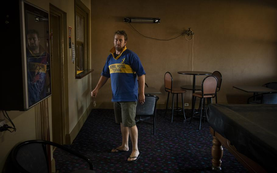 Mark Iles, publican at the Royal Hotel, holds a dead mouse in Yoeval, NSW, Australia, on May 28, 2021.