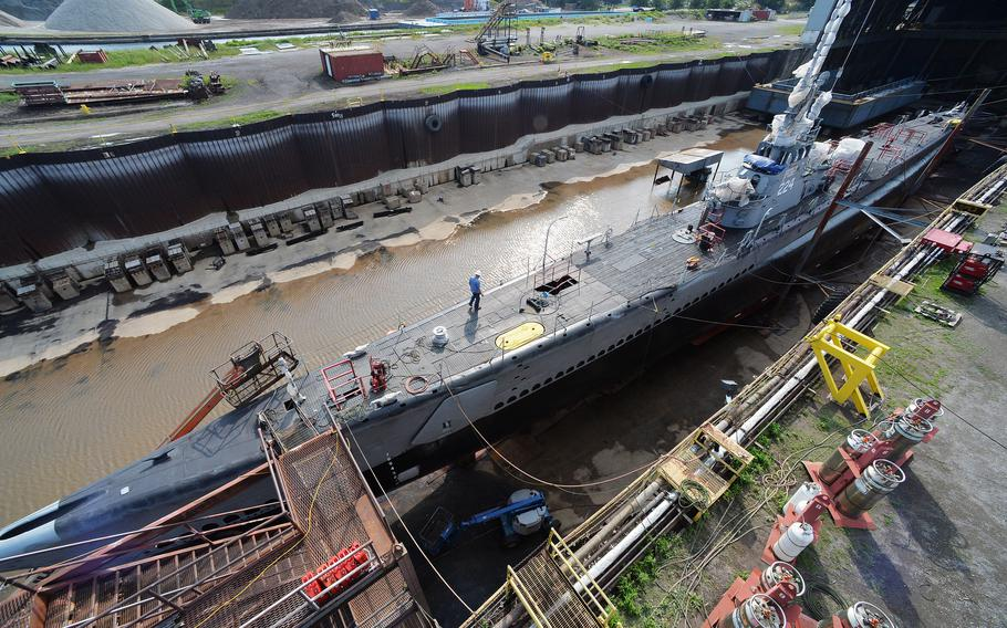 Repairs are nearing completion on the USS Cod submarine, shown on Wednesday, docked at Donjon Shipbuilding & Repair in Erie. The floating museum is usually docked in Cleveland and is ending about 6 weeks of steel hull repair and other maintenance.