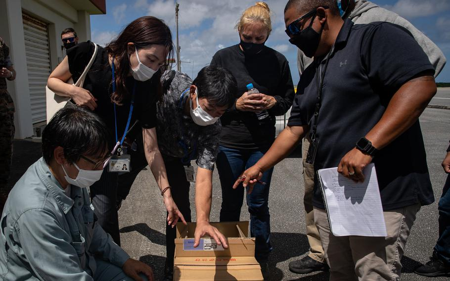 Japanese authorities collected samples of treated wastewater at Marine Corps Air Station Futenma, Okinawa, Japan, on July 19, 2021.