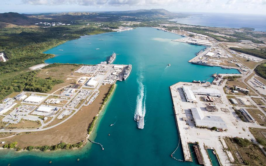 An aerial view of U.S. Naval Base Guam shows several Navy vessels moored in Apra Harbor, March 15, 2018.