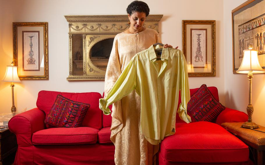 Hanan Elatr, the widow of dissident Saudi journalist Jamal Khashoggi, holds a shirt of his in July 2021 at a friend's Washington-area apartment. Her phone was secretly targeted before his 2018 murder.