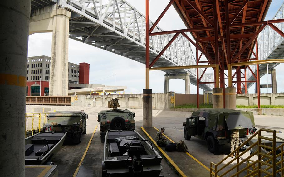 The Louisiana National Guard activated about 4,900 troops in advance of Hurricane Ida and received support of about 400 additional troops from three states. The Guard staged high-water vehicles and rescue boats and began clearing roads after the storm passed Monday morning.