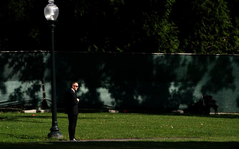 A Secret Service Agent watching during US President Joe Biden departure on the South Lawn at the White House in Washington on September 20, 2021. MUST CREDIT: Washington Post photo by Demetrius Freeman