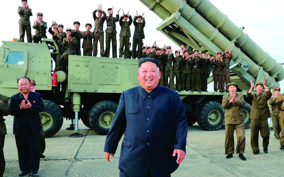 In this photo from the Korean Central New Agency, North Korean leader Kim Jong Un smiles after the test-firing of an unspecified missile at an undisclosed location, Aug. 24, 2019.