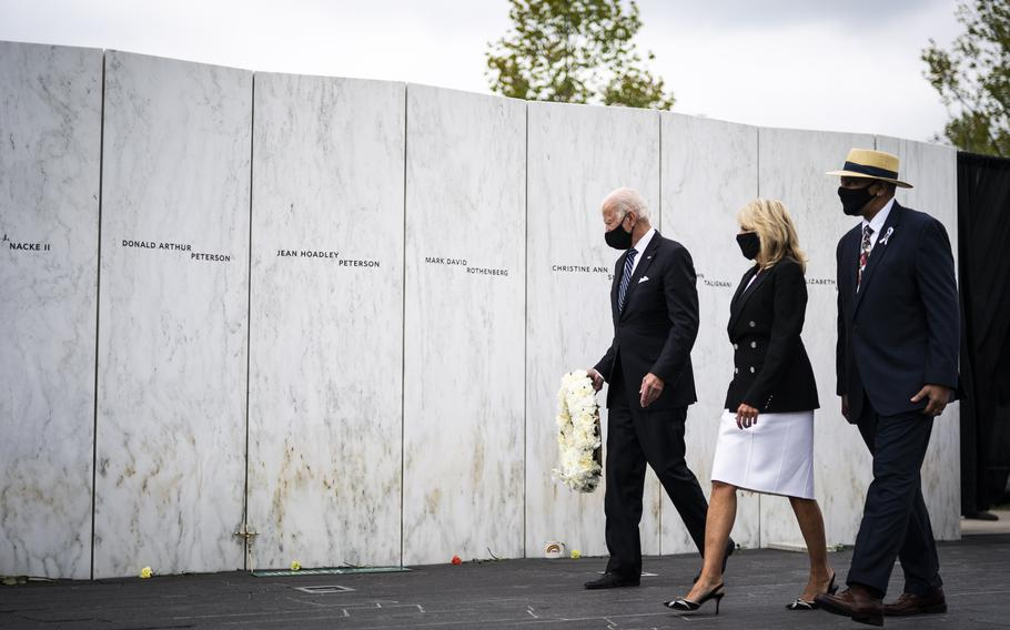 Joe Biden, then the Democratic presidential nominee, with wife Jill Biden, lays a wreath at the wall of names at the Flight 93 National Memorial on Sept. 11, 2020, in Shanksville, Pa.