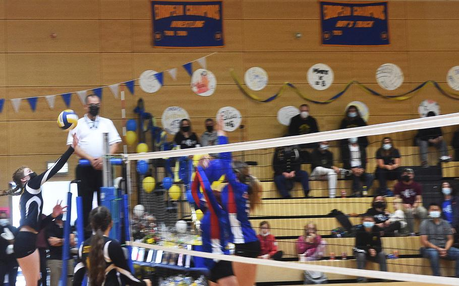 Stuttgart's Charity Clements taps the ball over the net during the Stuttgart-Ramstein volleyball game played in Wiesbaden on Saturday, Oct. 9, 2021.