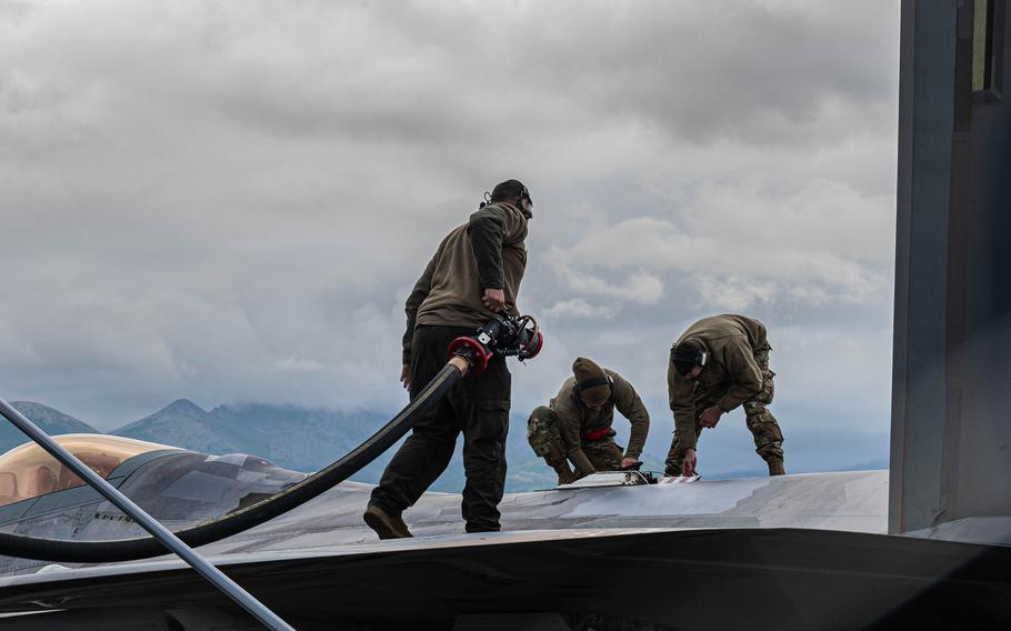 Airmen from Langley Air Force Base's 94th Fighter Squadron and 192nd Wing work on an F-22 during an exercise in Alaska.
