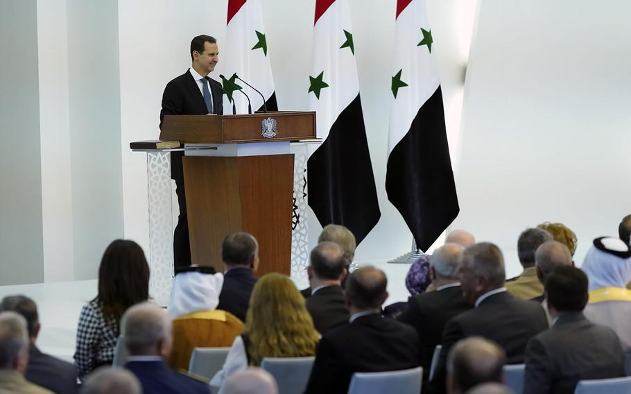 In this photo released by the official Facebook page of the Syrian Presidency, Syrian President Bashar Assad takes the oath of office for a fourth seven-year term, at the Syrian Presidential Palace in the capital Damascus, Syria, Saturday, July 17, 2021.