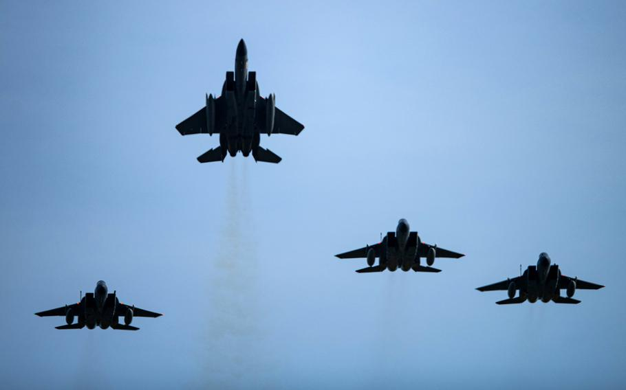 """U.S. Air Force F-15C Eagles assigned to the 493rd Fighter Squadron fly a missing man formation over RAF Lakenheath, England, June 15, 2021, to mark the one-year anniversary of the death of 1st Lt. Kenneth """"Kage"""" Allen, who was killed when his F-15C crashed into the North Sea."""