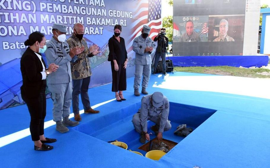 Representatives from the U.S. and Indonesia break ground on a maritime training center in Batam, Indonesia, Friday, June 25, 2021. The center is being built near the mouth of the Malacca Strait, a prime global shipping channel linking the Indian and Pacific oceans.