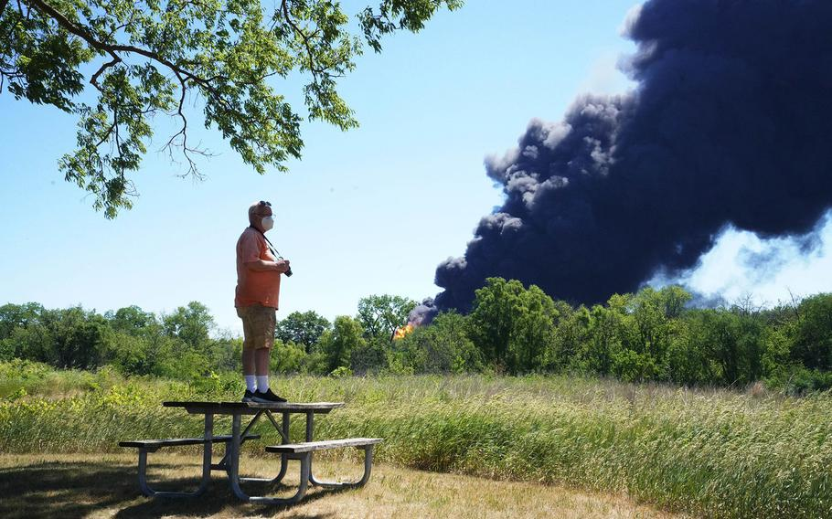 Neal Nuber, of South Beloit, watches the chemical fire at Chemtool Incorporated factory from the J. Norman Jensen Forest Preserve in South Beloit, Illinois, on June 14, 2021.