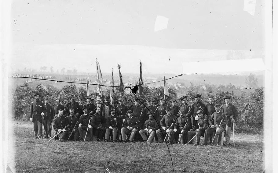 Union Army Lt. Col. James J. Smith and officers of the 69th New York Infantry (Irish Brigade) pose for a photo during the Civil War.