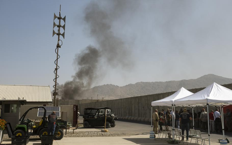 Americans burn sensitive material at a military base at Kabul's airport on Sunday, Aug. 15, 2021. Later that day, reports came of the Taliban's advance into Kabul's outer areas.