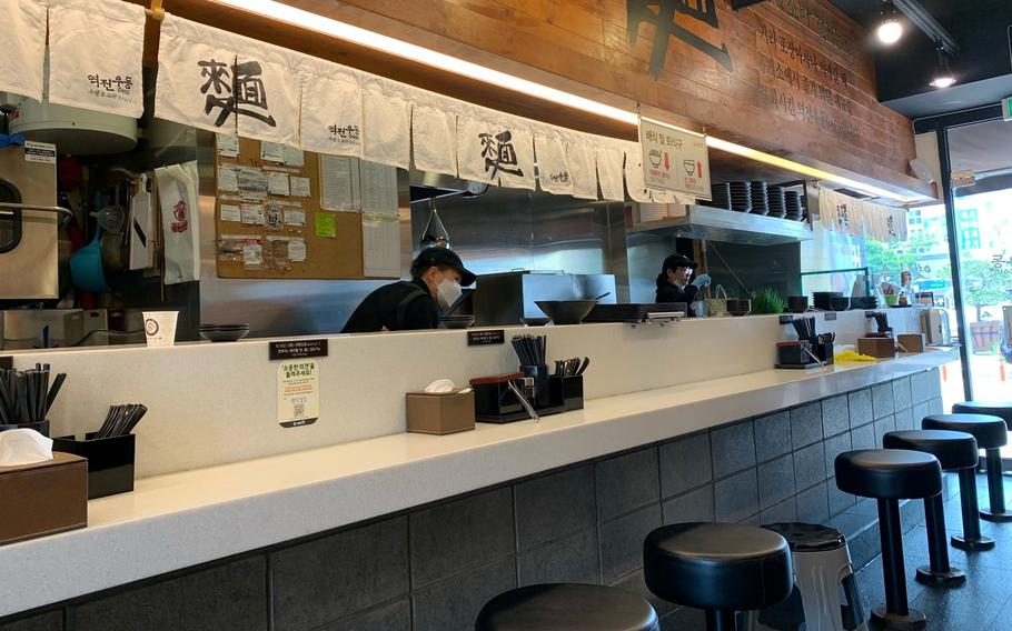 """Yeokjeon Udong 0410, which translates to """"udon in front of the station,"""" is a nod to South Korean celebrity chef Baek Jong-won's experience eating udon in Japan, a commuter meal often eaten alone or with one other person."""
