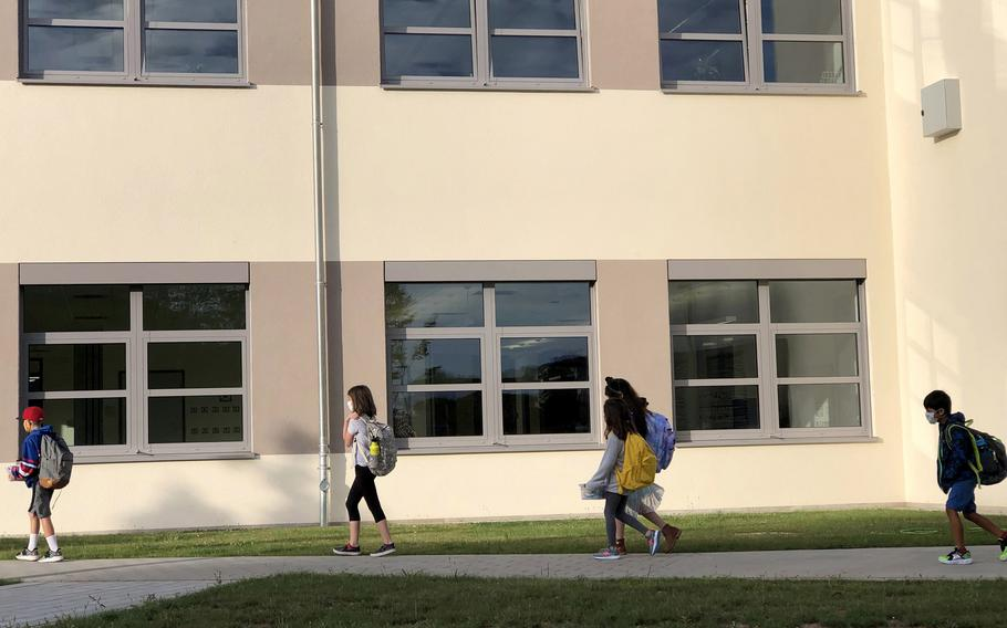 Students walk to class on the first day of school at Vogelweh Elementary School, Germany, Aug. 24, 2020. Sierra Eberhardt, a teacher at the U.S. base school, has been forced to pay about $150,000 in German income tax penalties despite a military treaty designed to put her pay off limits.