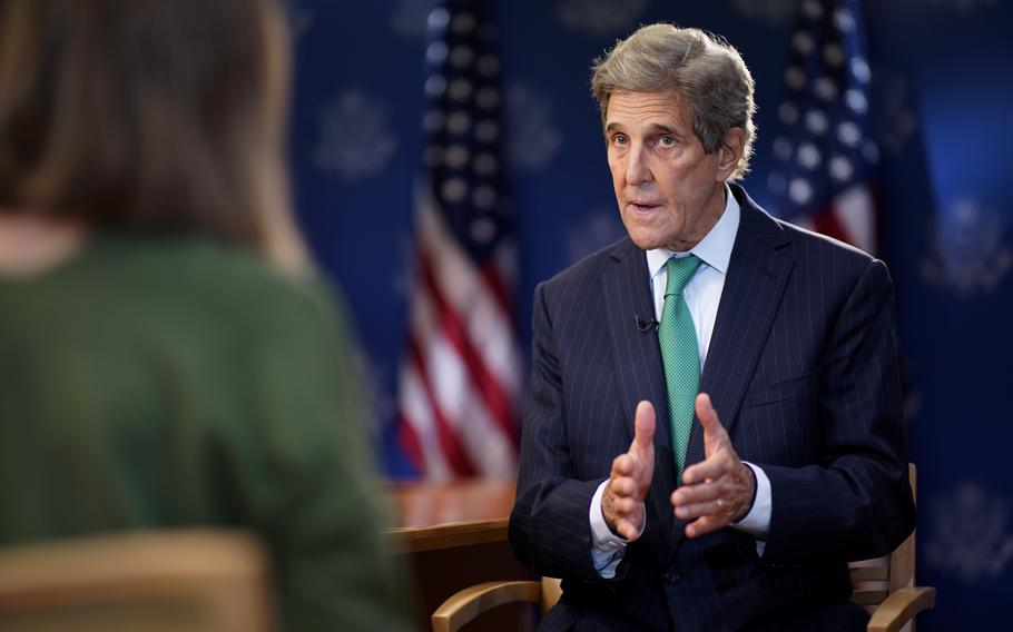 John Kerry, United States Special Presidential Envoy for Climate, speaks during an interview with The Associated Press, at the U.S. State Department in Washington.