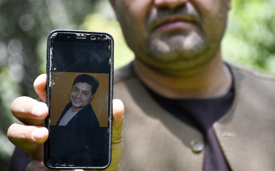 Afghan journalist Zainullah Stanikzai keeps photos on his phone of Aliyas Dayee, his friend and a fellow reporter, who was killed Nov. 12, 2020, in southern Helmand province when a bomb attached to his car detonated. Press freedom has been restricted since the Taliban took control of Afghanistan, a human rights group and Afghan journalists say.