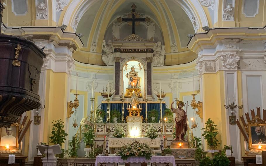 The interior of the Chiesa di Santa Maria della Pieta, or St. Mary of Mercy, on the island of Procida, Italy, is cozy but ornately decorated.