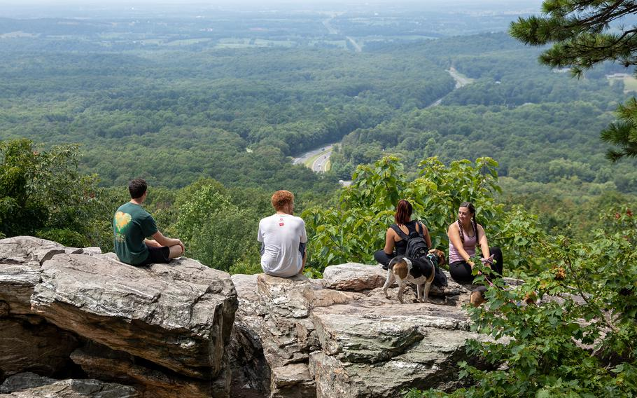 Hikers along the hilly stretch of the Appalachian Trail known as the Roller Coaster take in the view at Bear's Den Scenic Lookout in Virginia this month.