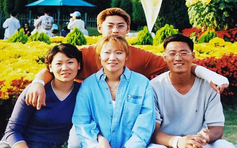 Hyon Chu DuCharme, center, poses with her siblings in this undated family photo.