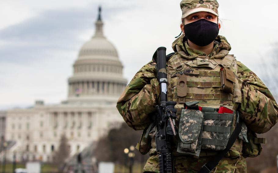 Army Pfc. Teri Oglesby of the Indiana National Guard provides security near the U.S. Capitol in Washington, March 1, 2021. The Guard could be forced to ground aircraft, cut back on training and curtail maintenance if it is not reimbursed by Aug. 1 for its mission to the Capitol.