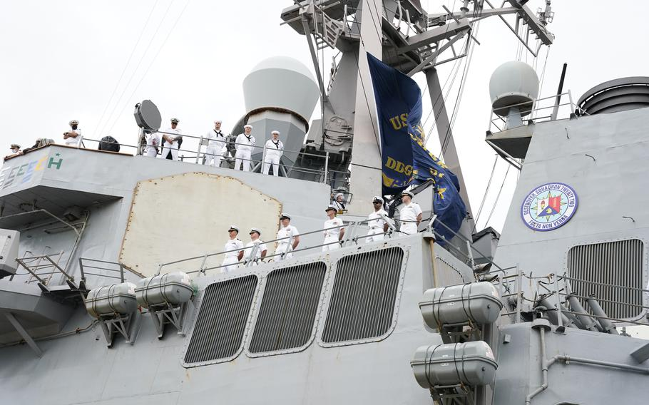 Sailors man the rails of the Arleigh Burke class guided-missile destroyer USS Mitscher (DDG 57) as the ship returns to Naval Station Norfolk on Sept. 17, 2021, to end a nine-month deployment.