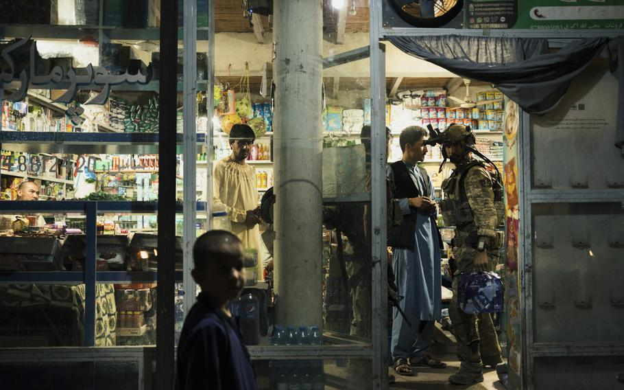 KKA forces stop for water in a local shop just a couple of miles from the front lines before a night mission in Kunduz, Afghanistan, on July 12, 2021.