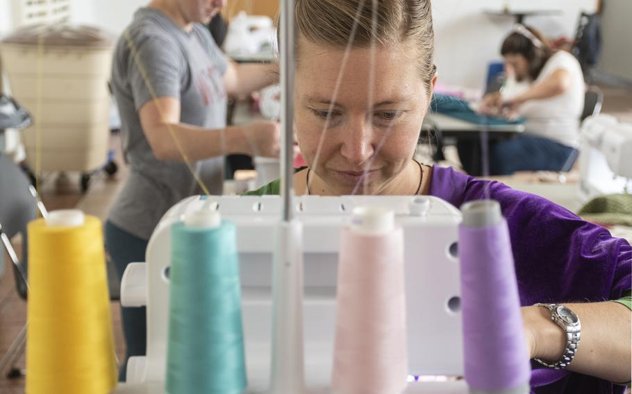 Lauren Williams sews a prayer garment for Afghan refugees at Ramstein Air Base on Aug. 26, 2021.