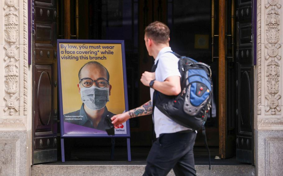 A sign informing customers they must wear a mask at the entrance to a NatWest Group bank branch in the City of London on June 7, 2021.