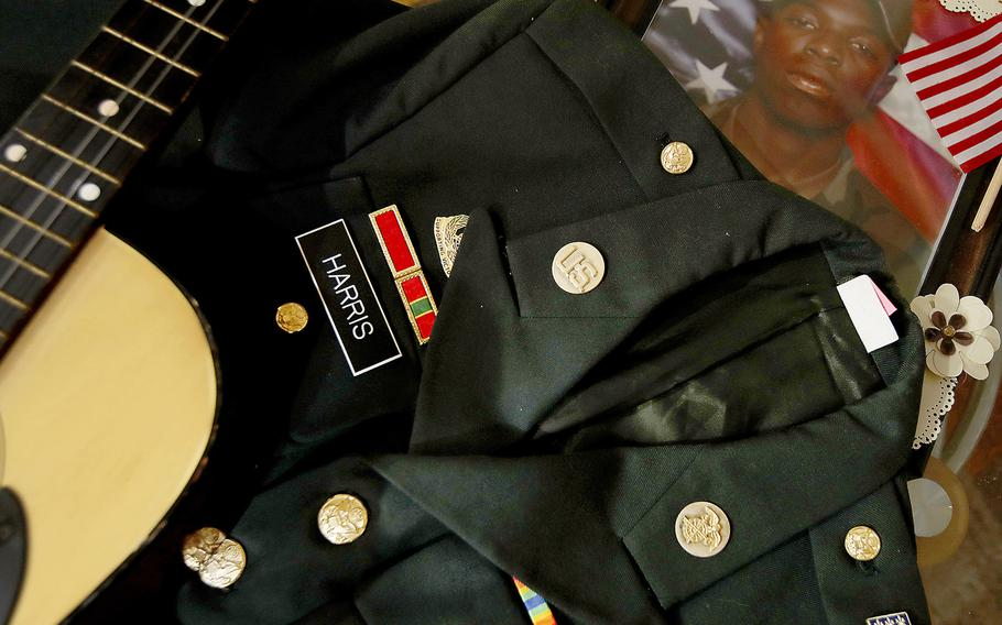 Mementos kept by the parents of Leroy Harris III, include his dress uniform jacket, his guitar and pictures from his days in the military. A soldier in the U.S. Army, Leroy Harris III was killed in action in 2004 in Iraq.