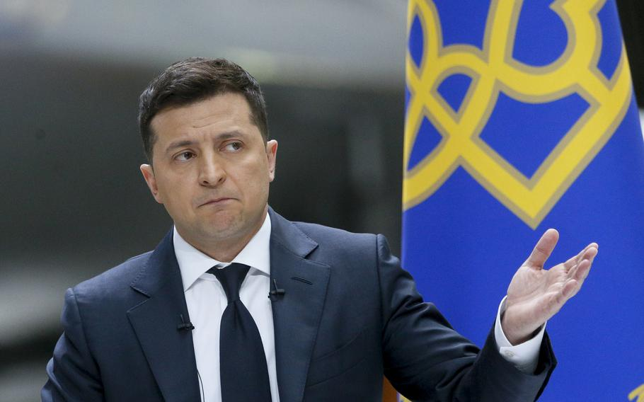 Ukrainian President Volodymyr Zelenskyy gestures while speaking to the media during a news conference with the Ukrainian Antonov An-225 Mriya airplane in the background at the Antonov aircraft factory in Kyiv, Ukraine, on Thursday, May 20, 2021.