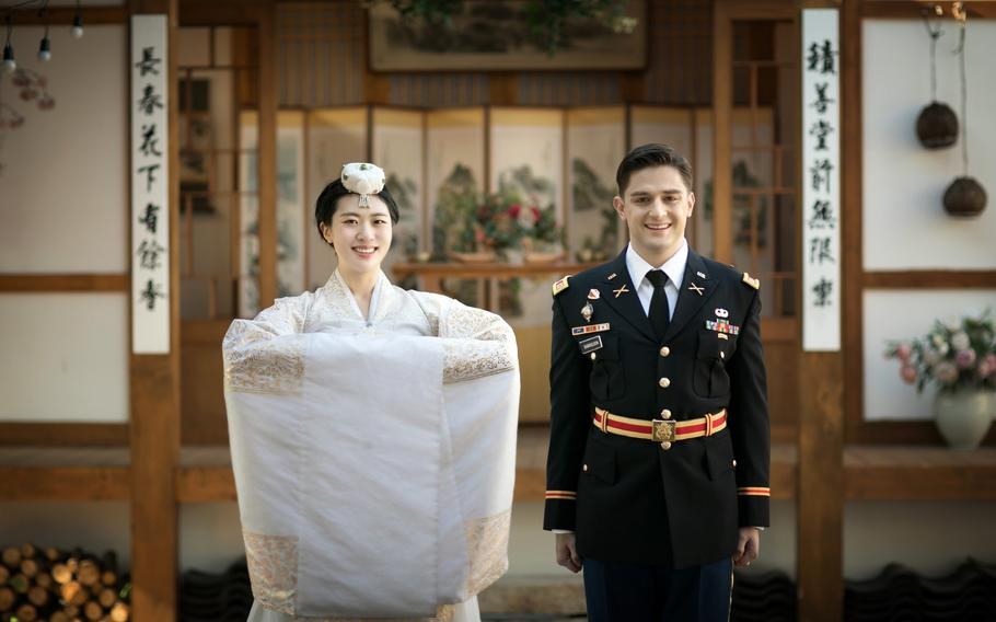 U.S. Army Capt. Miles Gabrielson and South Korean army Capt. Ha Neul, pose on their wedding day in Busan, South Korea, Feb. 20, 2021. In lieu of a honeymoon, the couple toured five South Korean cities with their families due to the coronavirus pandemic.