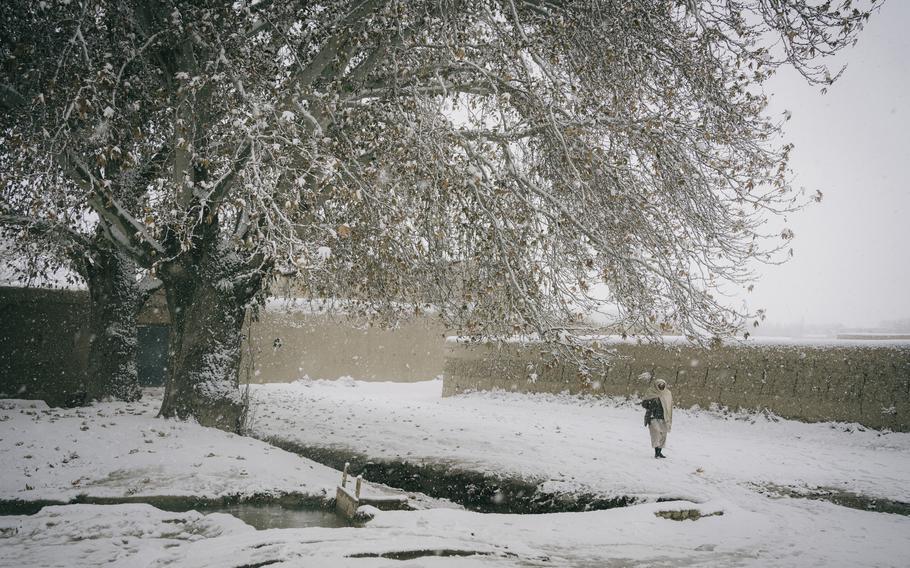 120p na               A man walks in the snow in Mazar-e Sharif. MUST CREDIT: Photo by Lorenzo Tugnoli for The Washington Post.