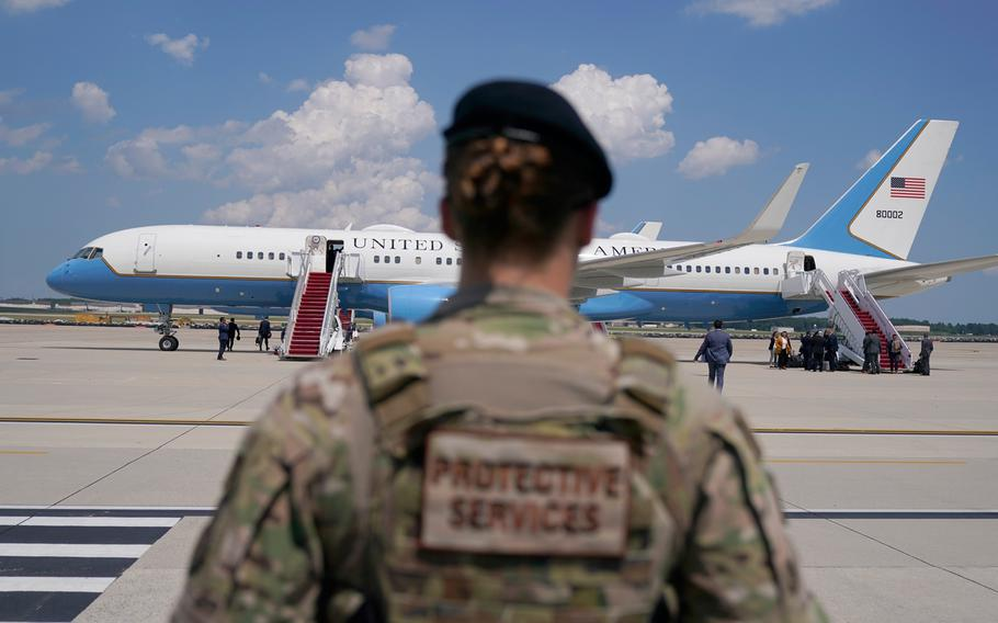 A member of the Air Force stands guard near Air Force Two at Andrews Air Force Base, Md., on June 6, 2021.