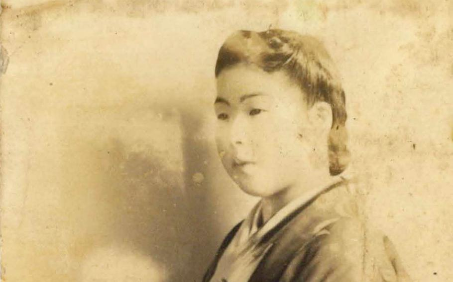 A photo of a woman in a kimono was one of five carried into combat by a Japanese soldier in World War II. They're back in their homeland after three quarters of a century in America.