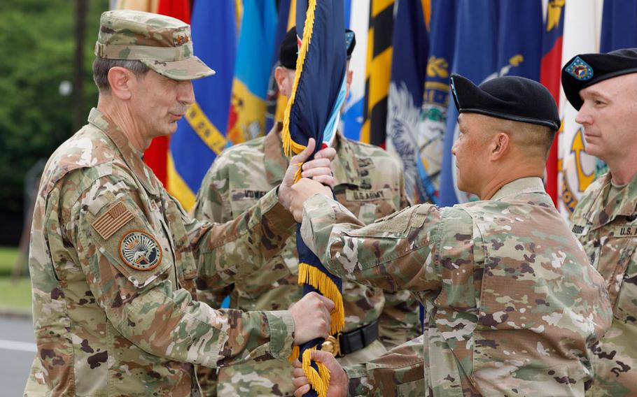 Maj. Gen. Viet X. Luong, right, passes the U.S. Army Japan guidon to U.S. Forces Japan commander Lt. Gen. Kevin Schneider at Camp Zama, Japan, Friday, June 25, 2021.