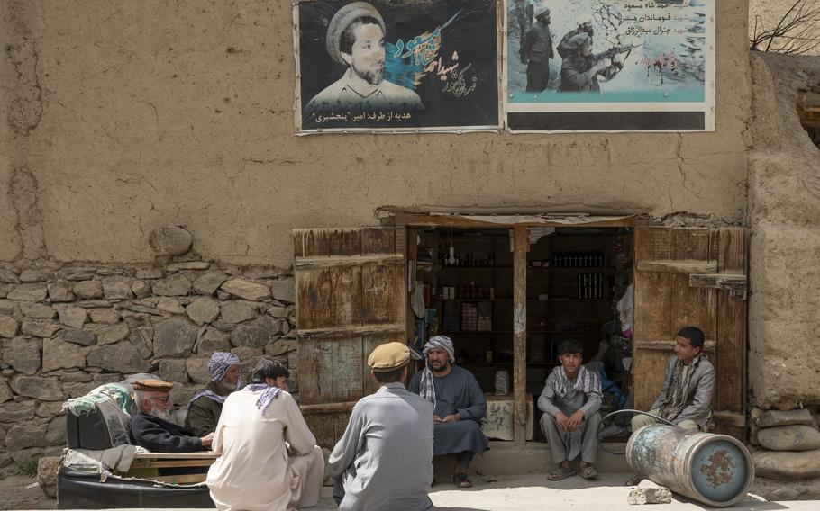 Residents in Panjshir province, Afghanistan, assemble under a poster of late anti-Taliban commander Ahmad Shah Massoud on April 27, 2021. Photos of Massoud are ubiquitous in the province.   Phillip Walter Wellman/Stars and Stripes