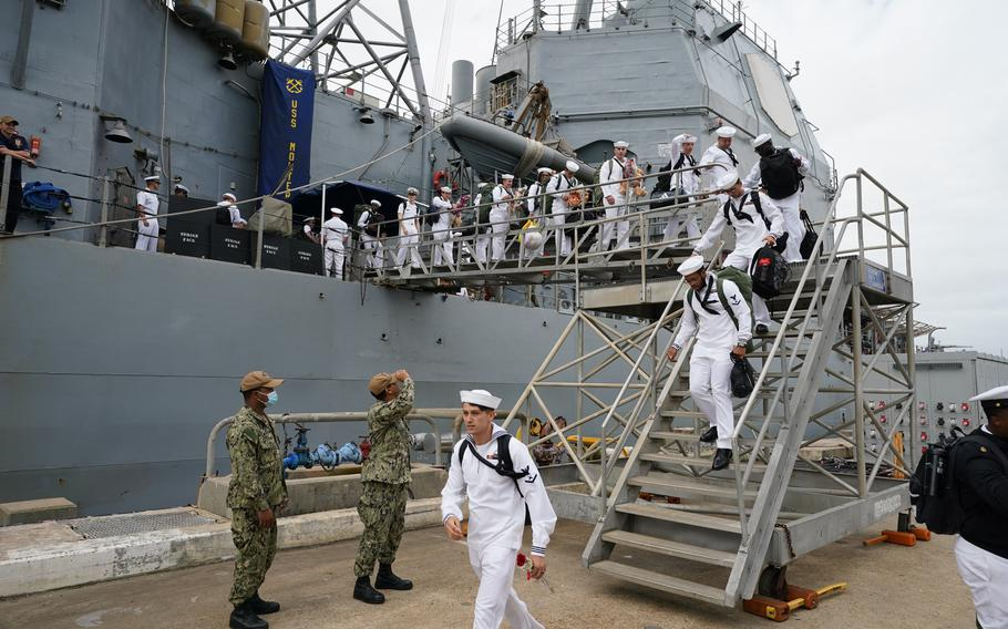 Sailors assigned to the Ticonderoga class guided-missile cruiser USS Monterey (CG 61) depart the ship following the ship's return to Naval Station Norfolk on Friday, Sept. 17, 2021.