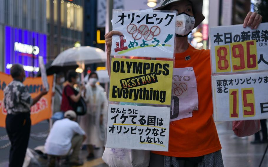 Anti-Olympics protestors hold a demonstration in central Tokyo, Thursday, July 8, 2021, the same day Japan's prime minister announced a fourth coronavirus state of emergency for the capital.