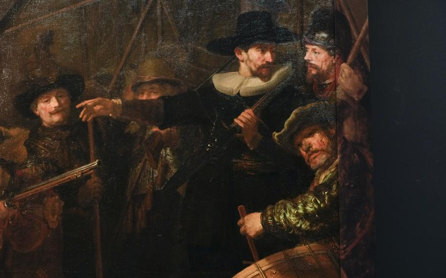 Detail of the Night Watch's right side, showing how Rembrandt's biggest painting just got bigger with the help of artificial intelligence in Amsterdam, Netherlands, Wednesday, June 23, 2021. The Dutch national museum and art gallery reveals findings from a long-term project to examine in minute detail Rembrandt van Rijn's masterpiece the Night Watch.