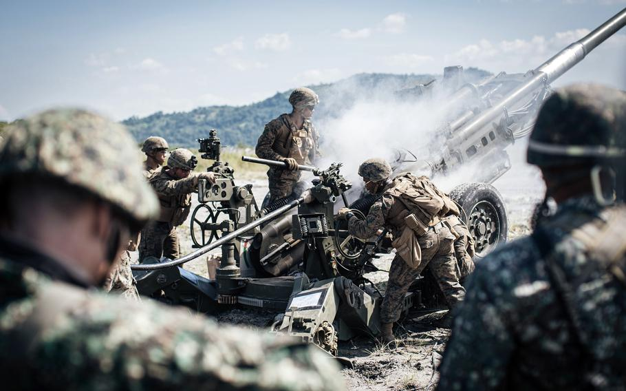 Philippine marines observe their U.S. counterparts conduct a fire mission at Colonel Ernesto Ravina Air Base, Philippines, during exercise Kamandag in 2019.