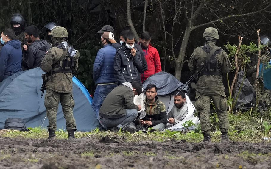 Polish security forces surround migrants stuck along with border with Belarus in Usnarz Gorny, Poland, on Sept. 1, 2021.