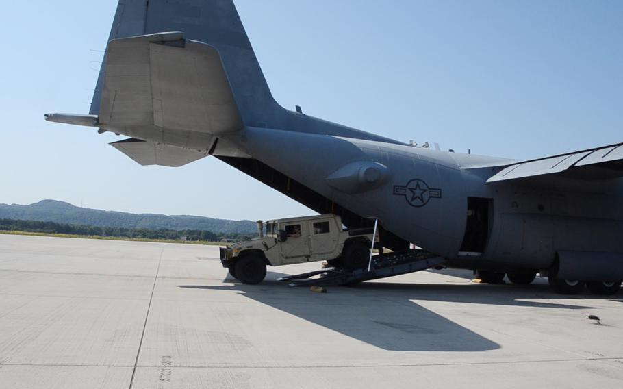 A Humvee is offloaded from a C-130H at Ramstein Air Base in Germany during the 721st Aerial Port Squadron Multi-Capable Airmen Rodeo, July 23, 2021.