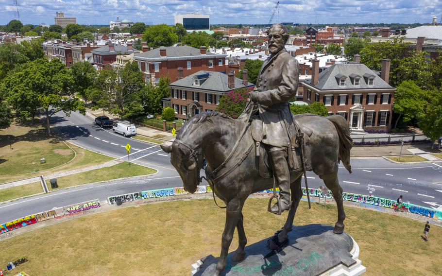 The statue of Confederate Gen. Robert E. Lee stands on Monument Avenue in Richmond, Va., on July 10, 2020. The Supreme Court of Virginia is set to hear arguments Tuesday, June 8, 2021, in legal challenges to Virginia Gov. Ralph Northam's plan to take down the 131-year-old statue.