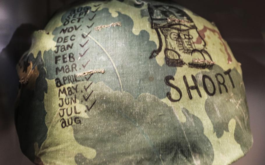 A helmet cover from Vietnam in 1968 at the National Museum of the United States Army on its reopening day, June 14, 2021.