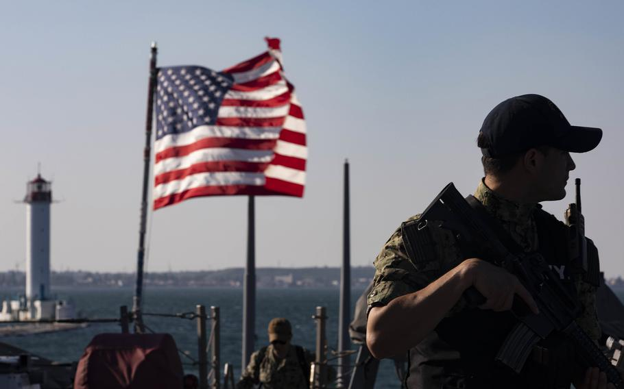 Petty Officer 2nd Class Emilio Orozco-Murcia stands watch aboard the destroyer USS Ross  in Odessa, Ukraine, for participation in Exercise Sea Breeze, June 27, 2021.