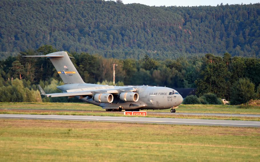 A U.S. Air Force C-17 aircraft carrying evacuees from Afghanistan lands at Ramstein Air Base, Germany, on Friday, Aug. 20, 2021.