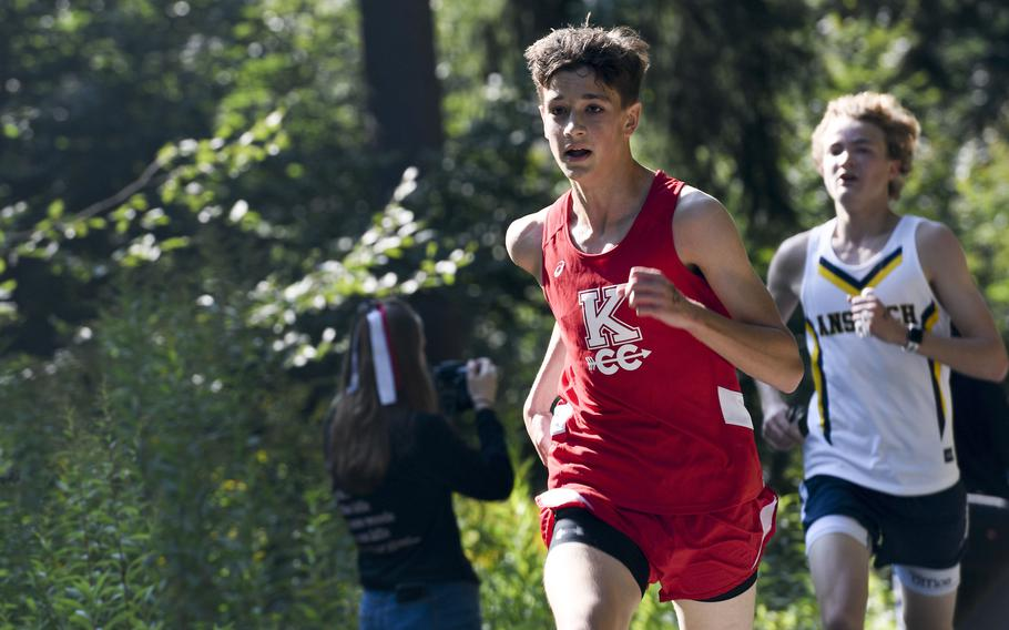 Brandon Maul, a runner at Kaiserslautern, overtakes another competitor during the final stretch of a high school boys' varsity cross country race Saturday, Sept. 18, 2021, in Kaiserslautern, Germany.