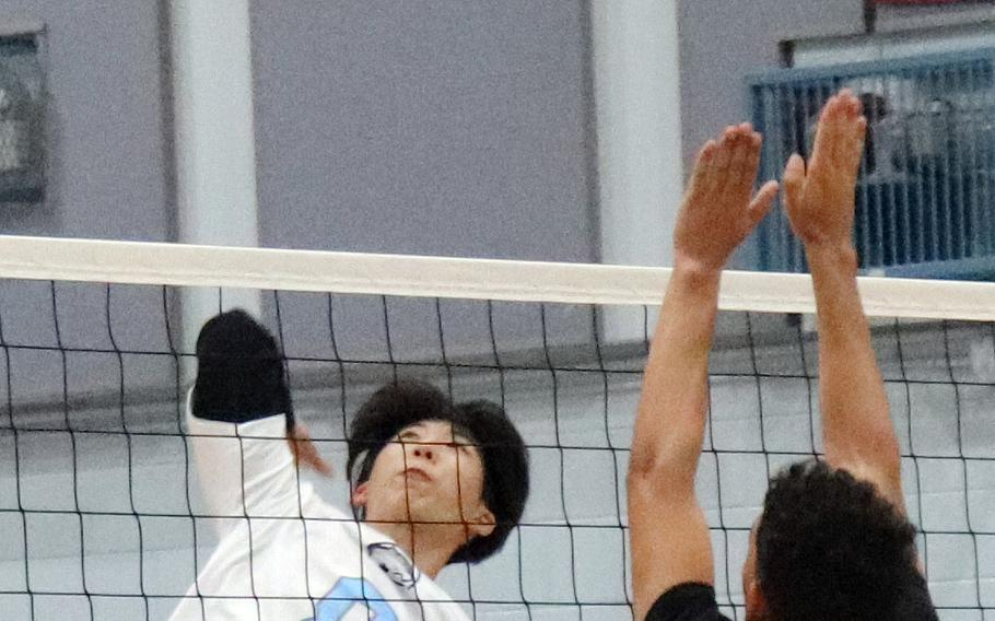 Timothy Petrae, left, is one of eight players returning to Osan's boys volleyball team.