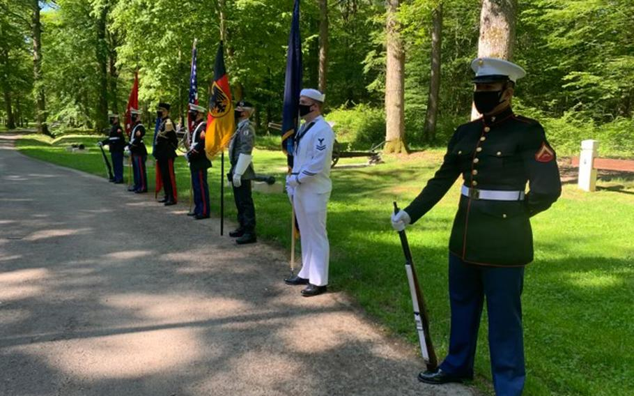 Lance Cpl. Carlos Rivera, a U.S. Marine Forces Europe and Africa administrative specialist, stands as part of the Color Guard for a memorial ceremony in Belleau Wood, France, on May 30, 2021.